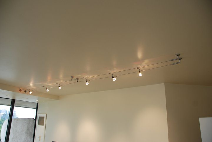 cable lighting over fireplace