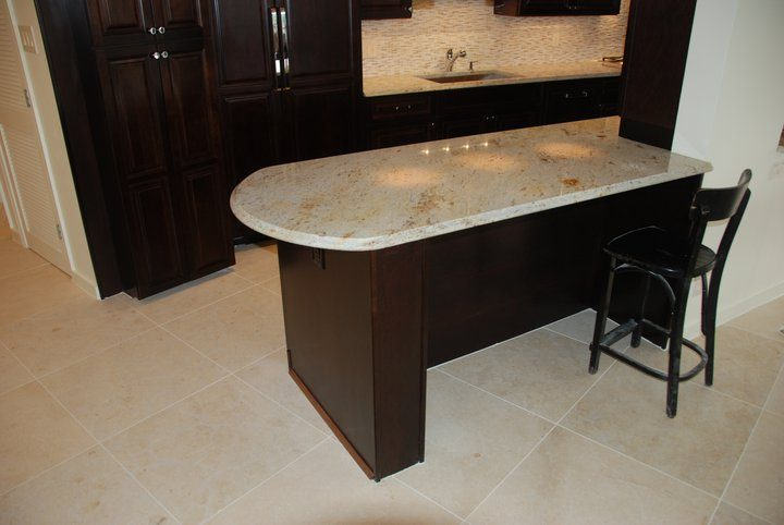 kitchen island with new sandstone floor